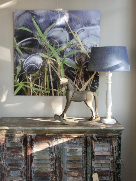 Fotokunst boven dressoir